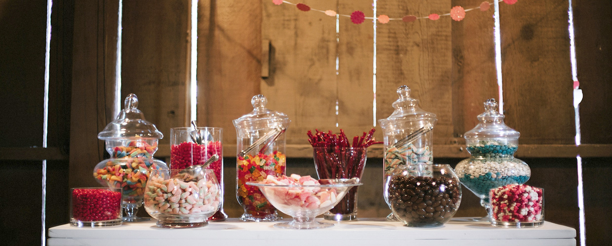 Table inside barn with candy display