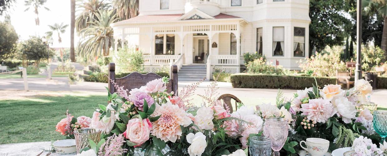 Wedding table with flowers in front of Ranch House